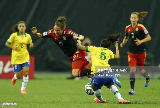 Gabi of Brazil and Sara Daebritz of Germany battle for the ball during the FIFA U20 Women's World Cup 2014 group B match between Brazil and Germany...
