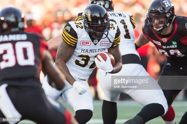 J Gable of the Hamilton TigerCats cuts up through a hole for a rushing gain against the Ottawa Redblacks in Canadian Football League Action at TD...