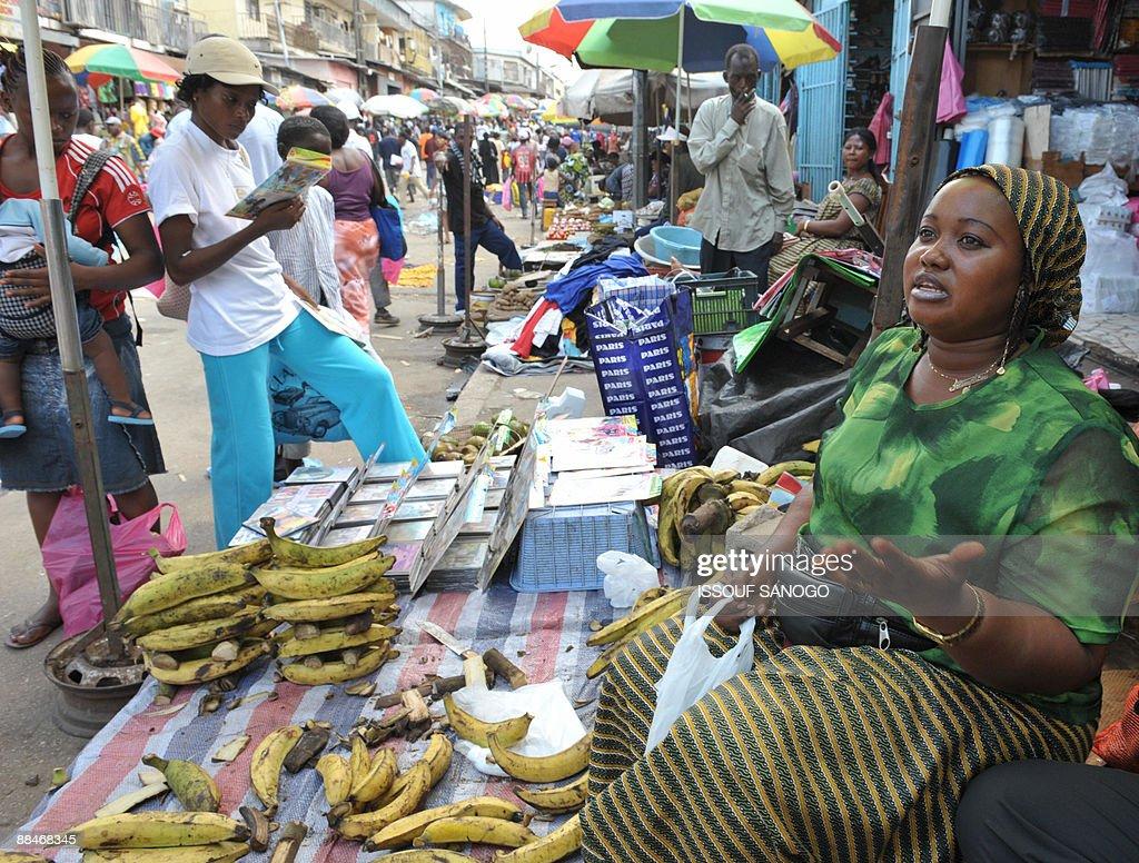 Gabonese fruit vendor Halima Marcelline sells her produce at a street market in Libreville on June 13 2009 AFP PHOTO / ISSOUF SANOGO