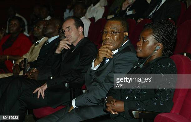 Gabonese Health minister Angelique Ngoma Gabonese Scientific Research minister Ondo Ossa with Professor Eric le Leroy attend the screening of a film...