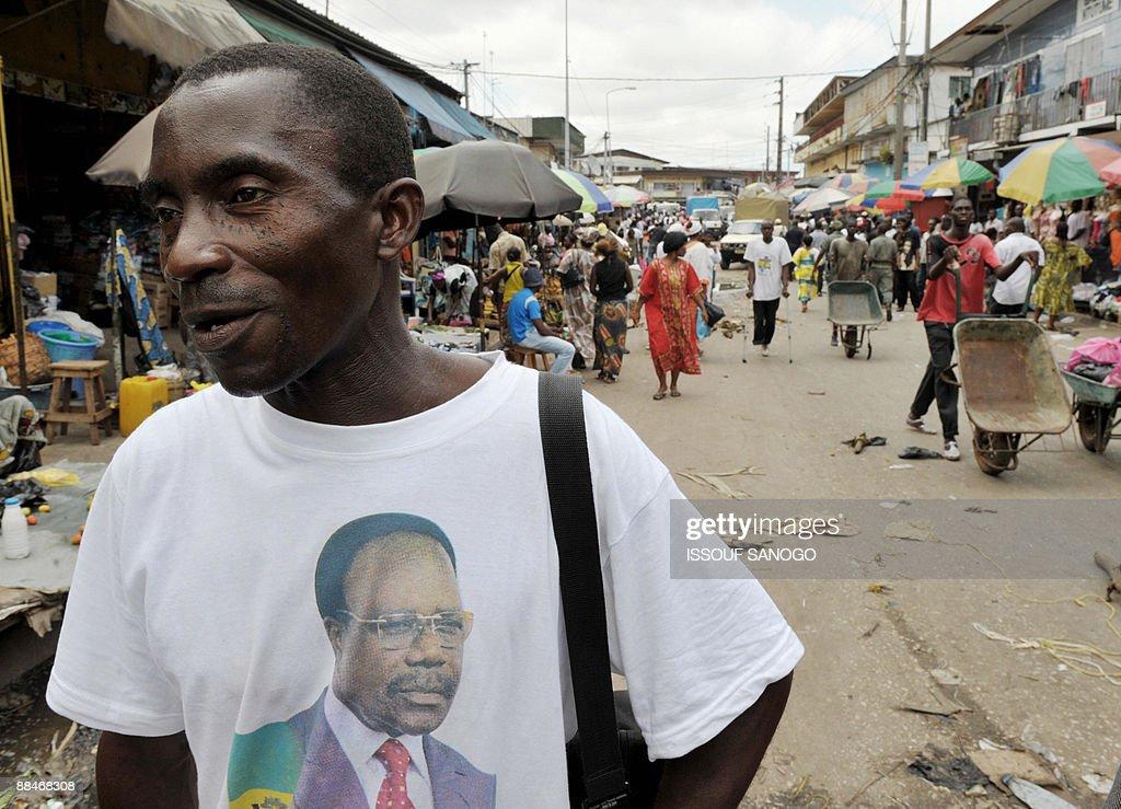 Gabonese man Gabriel Bakele Obiang wears a Tshirt bearing a picture of late president of Gabon Omar Bongo Ondimba as he walks along a street in...