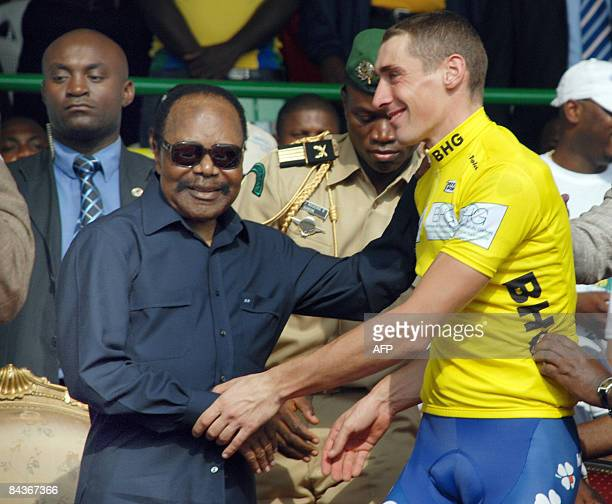 Gabonese President Omar Bongo congratulates Mathieu Ladagnous winner of the Fourth edition of the international cycling tour called 'Tropicale Amissa...
