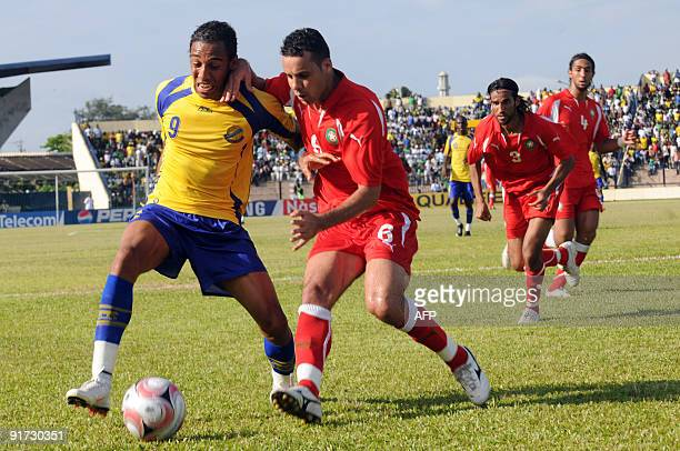 Gabon's forward Erbate El Amin vies with Morocco's Pierre Emerick Aubame Eyang during their World Cup 2010 qualification match on October 10 2009 in...