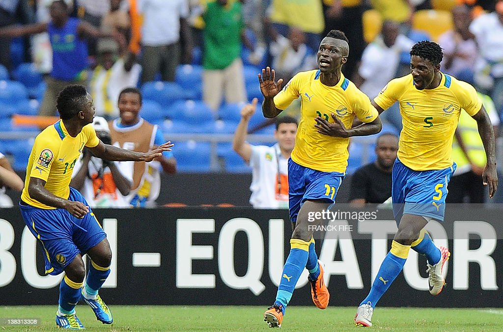 Gabon's forward Eric Mouloungui celebrates with his teammates after scoring the opening a goal during the Africa Cup of Nations quarterfinal football...