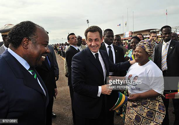 Gabon's President Ali Bongo Ondimba presents his mother Patience Dabany to his French counterpart Nicolas Sarkozy up on Sarkozy's arrival on February...