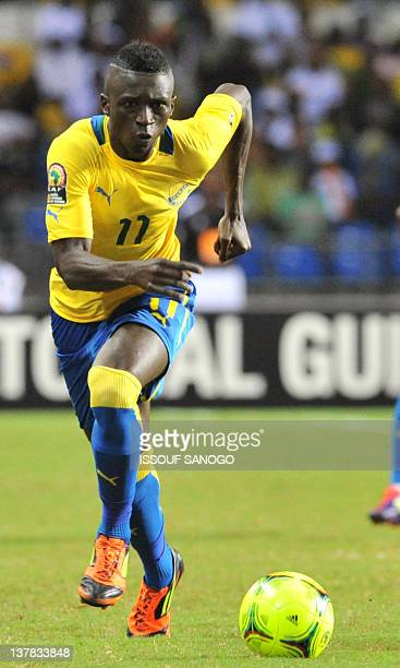 Gabon's striker Eric Mouloungui eyes the ball during the Africa Cup of Nations 2012 Group C football match between Gabon and Morocco at the stade de...