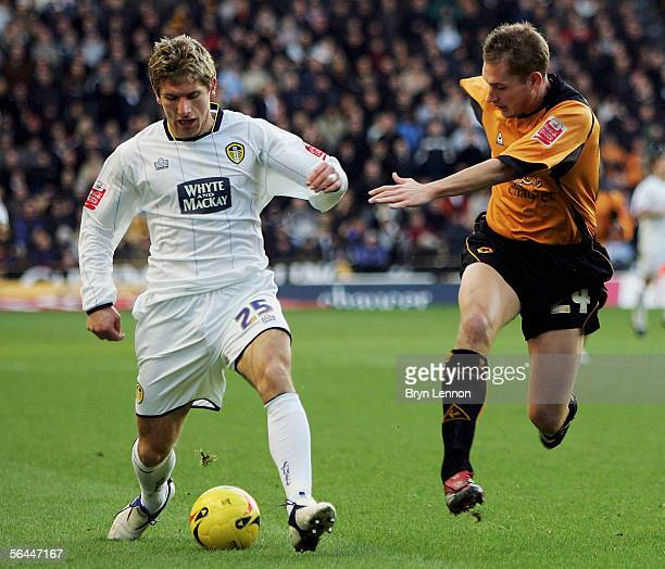 Gabor Gyepes of Wolverhampton Wanderers challenges Richard Cresswell of Leed United during the CocaCola Championship match between Wolverhampton...