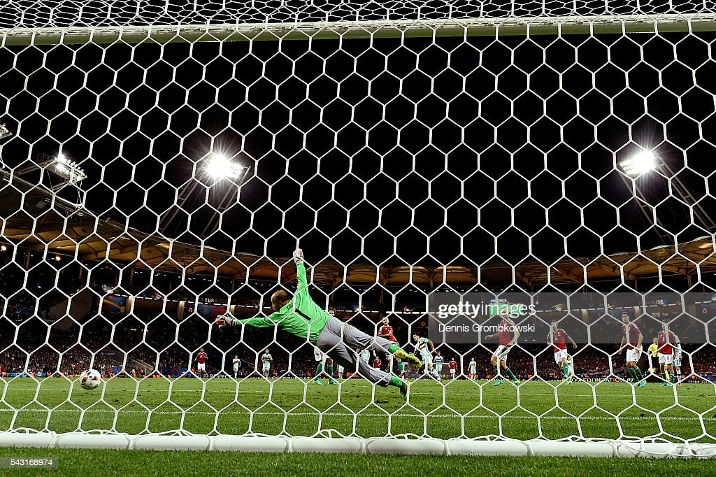 Gabor Kiraly of Hungary dives in vain as <a gi-track='captionPersonalityLinkClicked' href=/galleries/search?phrase=Eden+Hazard&family=editorial&specificpeople=5539543 ng-click='$event.stopPropagation()'>Eden Hazard</a> of Belgium scores his team's third goal during the UEFA EURO 2016 round of 16 match between Hungary and Belgium at Stadium Municipal on June 26, 2016 in Toulouse, France.