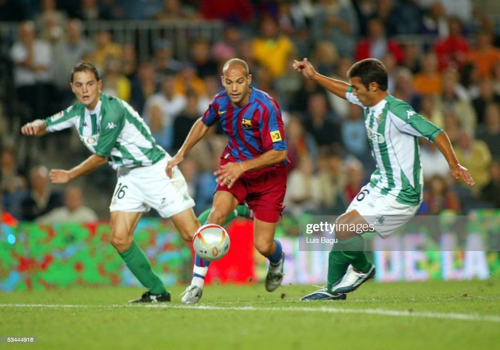 Gabri of FC Barcelona runs between Oscar Lopez and Xisco of Betis during the match between FC Barcelona and Real Betis during the Spain Supercup...