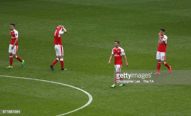 Gabriel Aaron Ramsey Mesut Ozil and Granit Xhaka of Arsenal react after Manchester City's first goal during the Emirates FA Cup SemiFinal match...