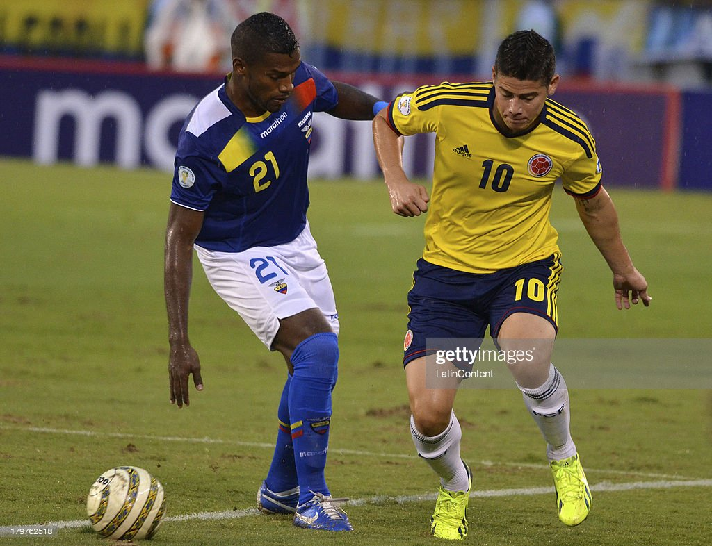 Gabriel Achiler of Ecuador (L) and <a gi-track='captionPersonalityLinkClicked' href=/galleries/search?phrase=James+Rodriguez&family=editorial&specificpeople=4422074 ng-click='$event.stopPropagation()'>James Rodriguez</a> of Colombia (R) fight for the ball during a match between Colombia and Ecuador as part of the 15th round of the South American Qualifiers at Metropolitano Roberto Melendez Stadium on September 06, 2013 in Barranquilla, Colombia.