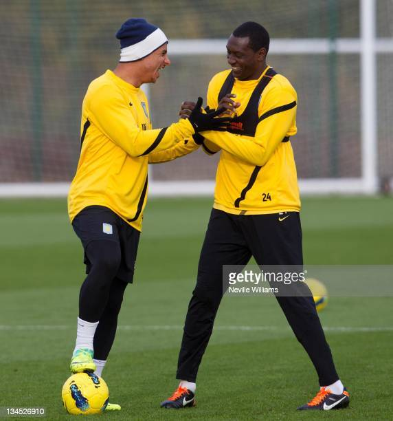 Gabriel Agbonlahor and Emile Heskey compete for the ball during an Aston Villa training session at the club's training ground at Bodymoor Heath on...
