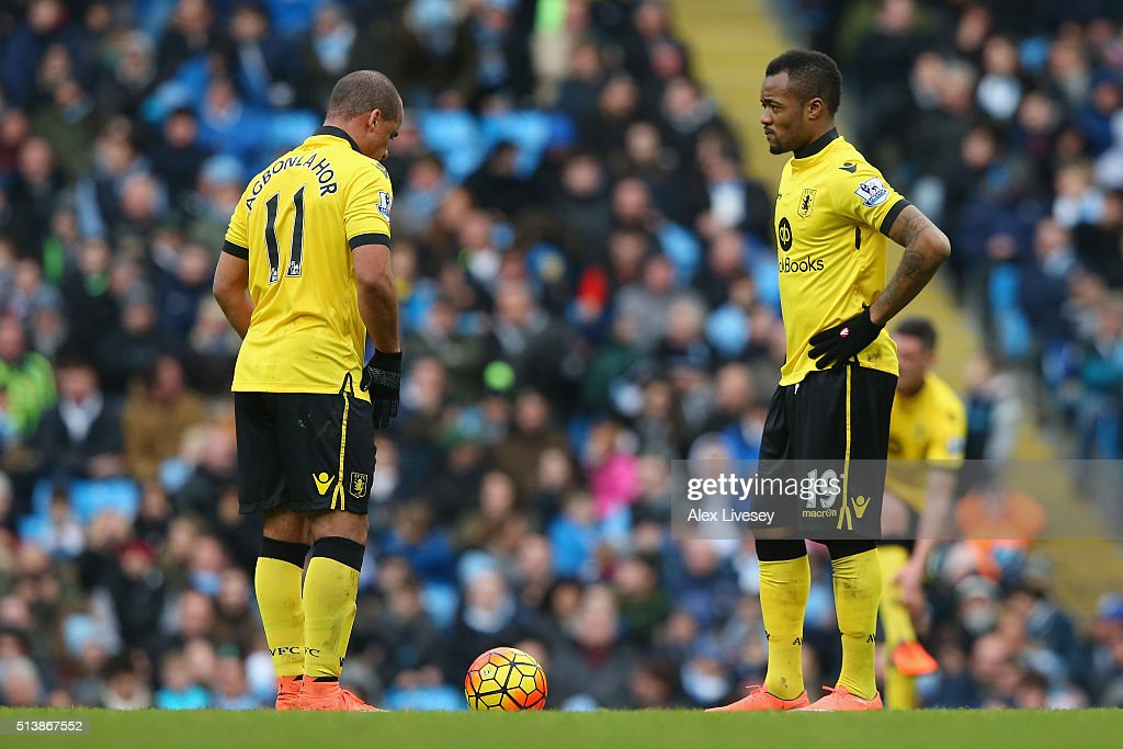 Gabriel Agbonlahor (L) and Jordan Ayew (R) of Aston Villa show their frustration after Machester City's fourth goal during the Barclays Premier League match between Manchester City and Aston Villa at Etihad Stadium on March 5, 2016 in Manchester, England.
