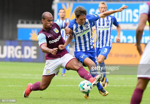 Gabriel Agbonlahor of Aston Villa and Genki Haraguchi of Hertha BSC during the game between Aston Villa and Hertha BSC on july 23 2017 in Duisburg...