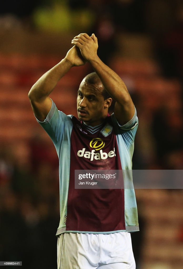 Gabriel Agbonlahor of Aston Villa applauds the travelling fans after victory in the Barclays Premier League match between Sunderland and Aston Villa at Stadium of Light on January 1, 2014 in Sunderland, England.