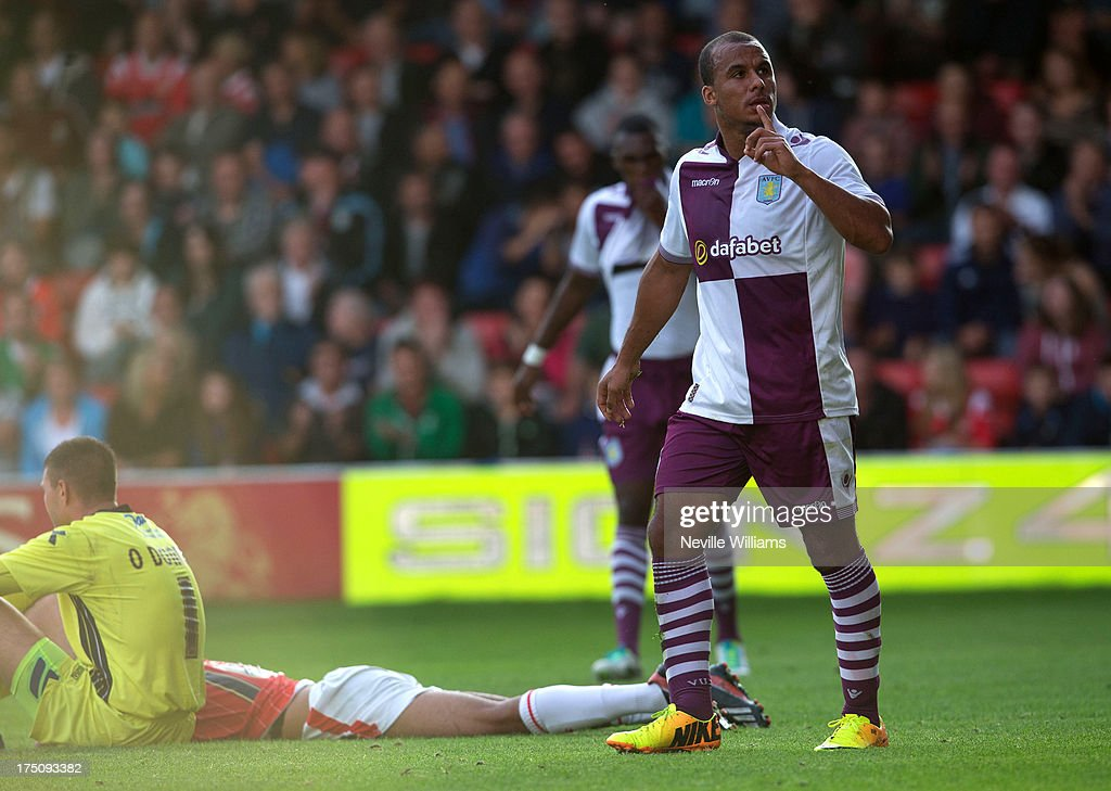 <a gi-track='captionPersonalityLinkClicked' href=/galleries/search?phrase=Gabriel+Agbonlahor&family=editorial&specificpeople=662025 ng-click='$event.stopPropagation()'>Gabriel Agbonlahor</a> of Aston Villa celebrates during the Pre Season Friendly match between Walsall and Aston Villa at Banks' Stadium on July 31, 2013 in Walsall, England.