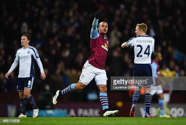 Gabriel Agbonlahor of Aston Villa celebrates scoring the opening goal during the Barclays Premier League match between Aston Villa and West Bromwich...