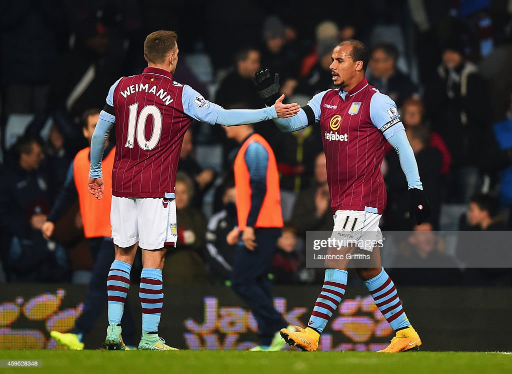 Gabriel Agbonlahor of Aston Villa (11) celebrates with Andreas Weimann as he scores their first goal during the Barclays Premier League match between Aston Villa and Southampton at Villa Park on November 24, 2014 in Birmingham, England.