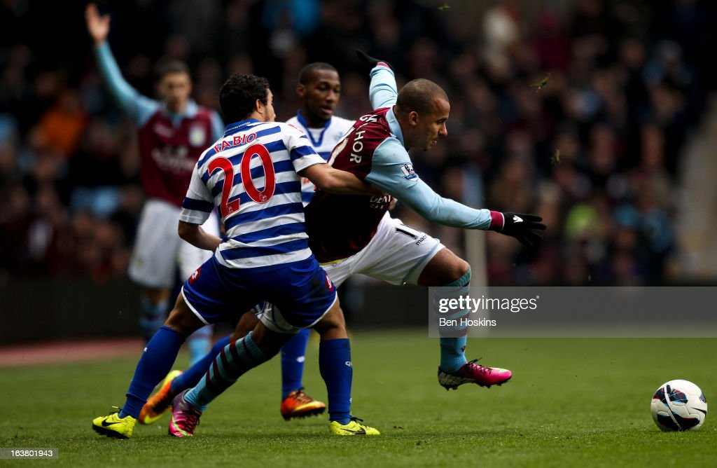Gabriel Agbonlahor of Aston Villa fends off the challenge of Fabio of QPR during the Barclays Premier League match between Aston Villa and Queens Park Rangers at Villa Park on March 16, 2013 in Birmingham, England.