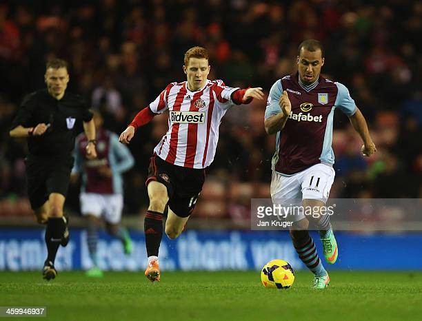 Gabriel Agbonlahor of Aston Villa holds off Jack Colback of Sunderland during the Barclays Premier League match between Sunderland and Aston Villa at...