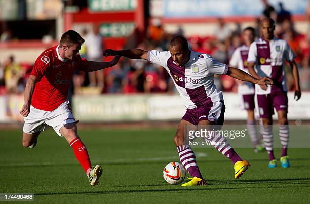 Gabriel Agbonlahor of Aston Villa in action with Oliver Turton of Crewe Alexandra during the Pre Season Friendly match between Crewe Alexandra and...