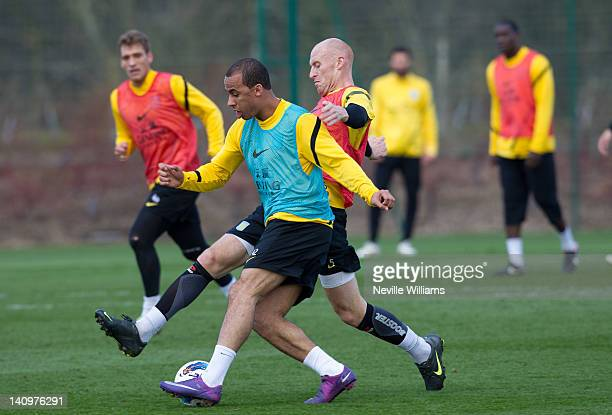 Gabriel Agbonlahor of Aston Villa in action with team mate James Collins during a Aston Villa training session at the club's training ground at...