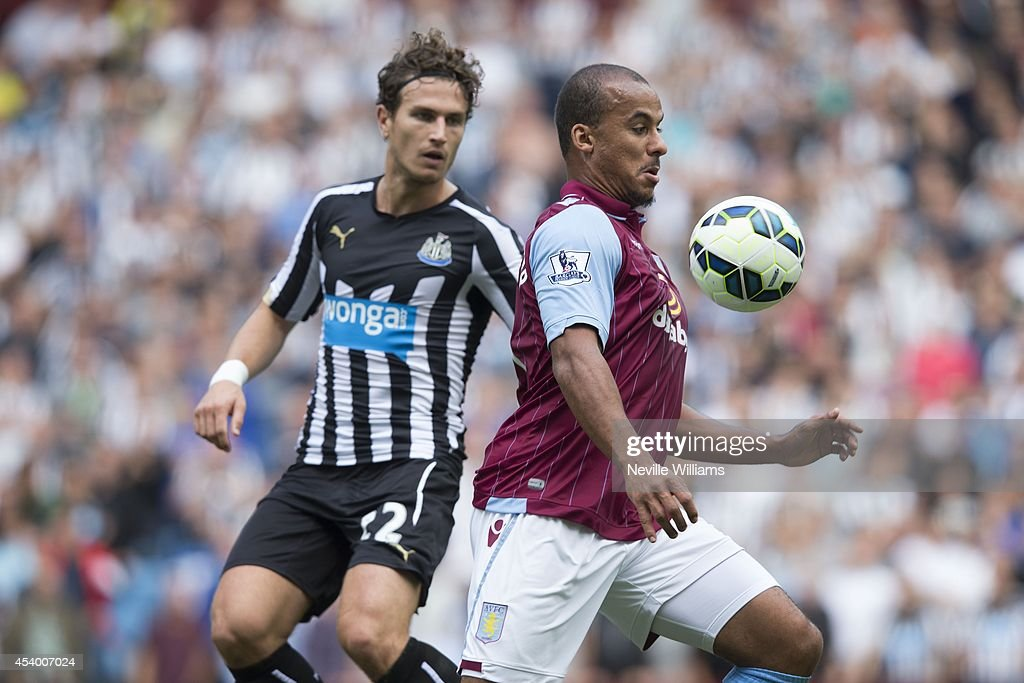 Gabriel Agbonlahor (R) of Aston Villa is challenged by Daryl Janmaat of Newcastle United during the Barclays Premier League match between Aston Villa and Newcastle United at Villa Park on August 23, 2014 in Birmingham, England.