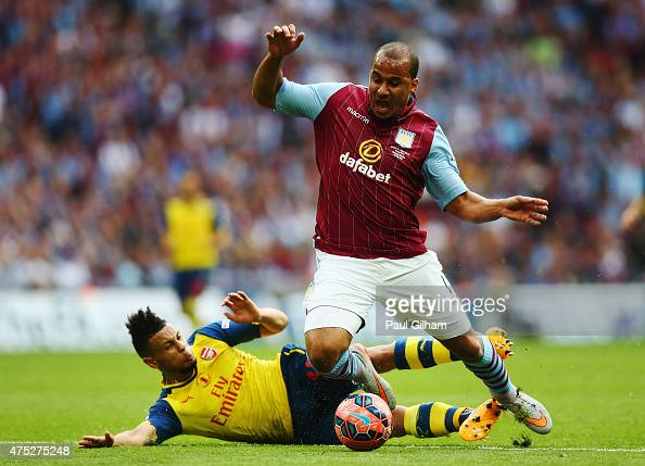 Gabriel Agbonlahor of Aston Villa is challenged by Francis Coquelin of Arsenal during the FA Cup Final between Aston Villa and Arsenal at Wembley...