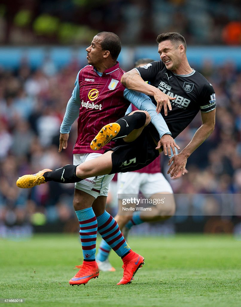 Gabriel Agbonlahor of Aston Villa is challenged by Jason Shackell of Burnley during the Barclays Premier League match between Aston Villa and Burnley at Villa Park on May 24, 2015 in Birmingham, England.