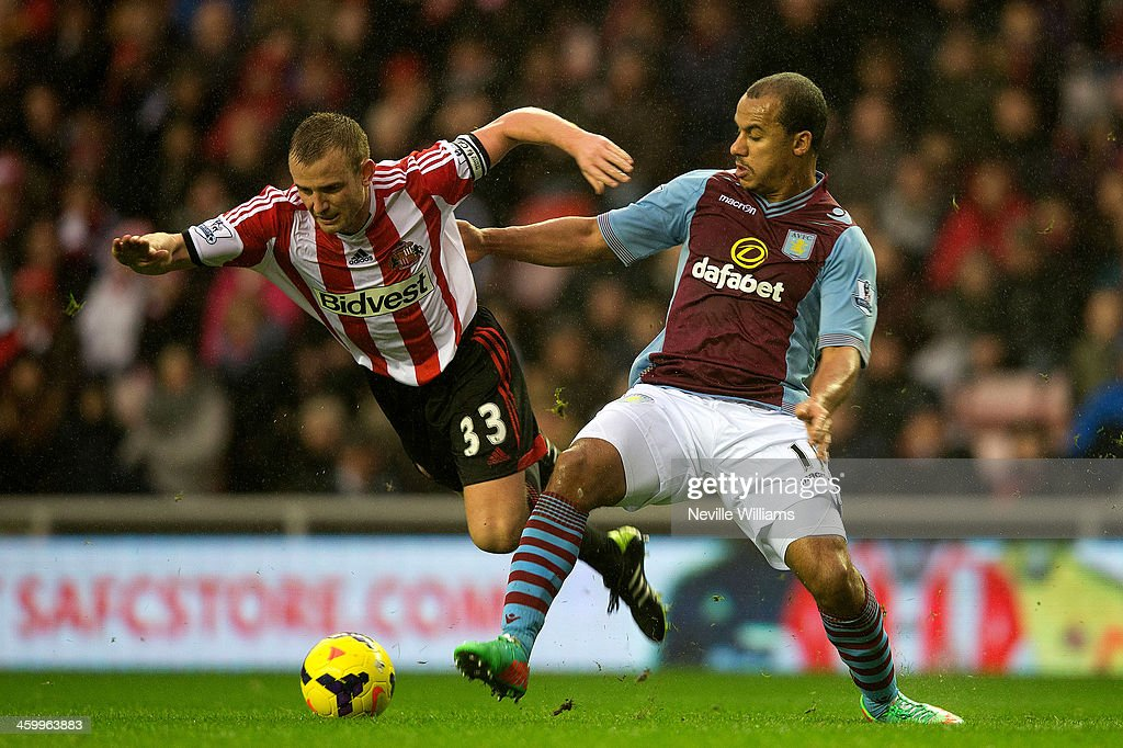 Gabriel Agbonlahor of Aston Villa is challenged by Lee Cattermole of Sunderland during the Barclays Premier League match between Sunderland and Aston Villa at the Stadium of Light on January 01, 2014 in Sunderland, England.