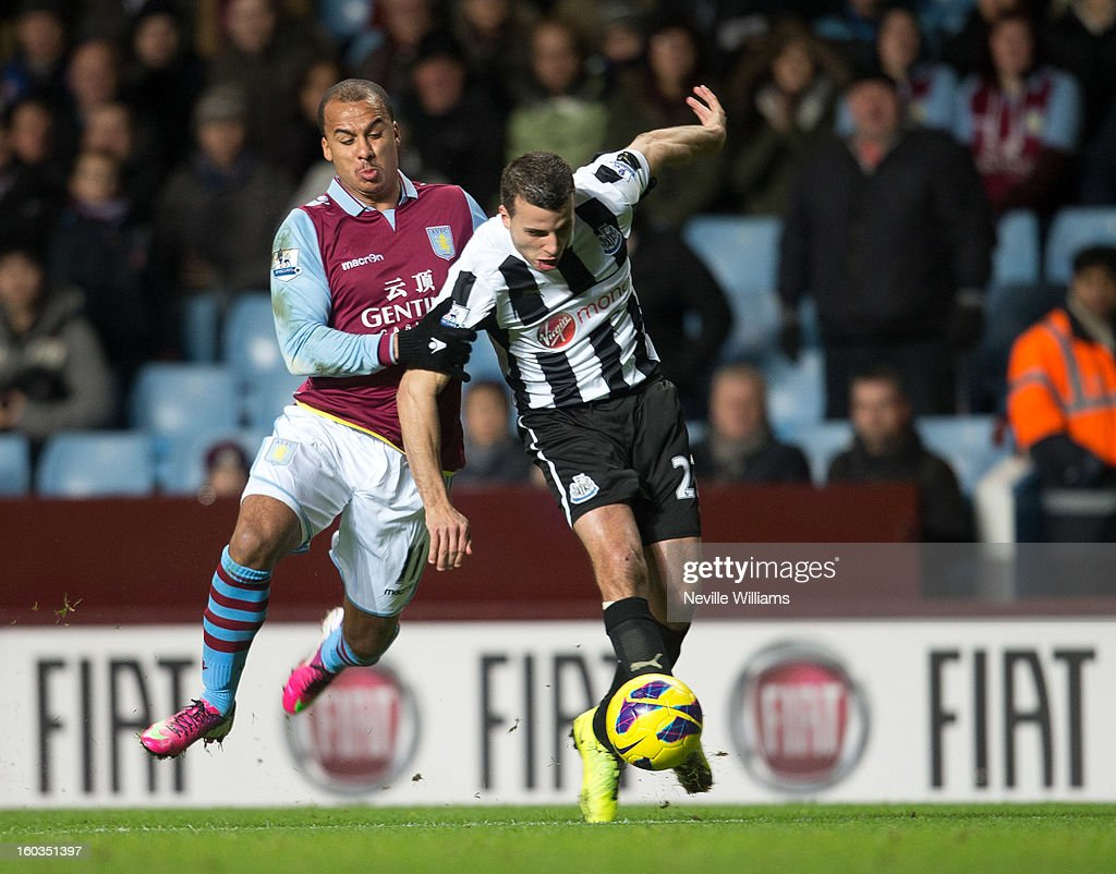 <a gi-track='captionPersonalityLinkClicked' href=/galleries/search?phrase=Gabriel+Agbonlahor&family=editorial&specificpeople=662025 ng-click='$event.stopPropagation()'>Gabriel Agbonlahor</a> of Aston Villa is challenged by <a gi-track='captionPersonalityLinkClicked' href=/galleries/search?phrase=Steven+Taylor+-+Soccer+Player+-+Born+1986&family=editorial&specificpeople=15163241 ng-click='$event.stopPropagation()'>Steven Taylor</a> of Newcastle United during the Barclays Premier League match between Aston Villa and Newcastle United at Villa Park on January 29, 2013 in Birmingham, England.