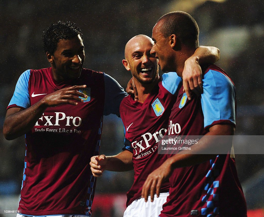 Gabriel Agbonlahor (R) of Aston Villa is congratulated on his goal by Stephen Ireland (C) and Habib Beye during the UEFA Europa League play off second leg match between Aston Villa and SK Rapid Vienna at Villa Park on August 26, 2010 in Birmingham, England.