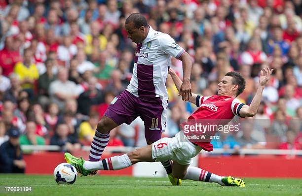 Gabriel Agbonlahor of Aston Villa is fouled by Laurent Koscielny of Arsenal for the second penalty of the match during the Barclays Premier League...