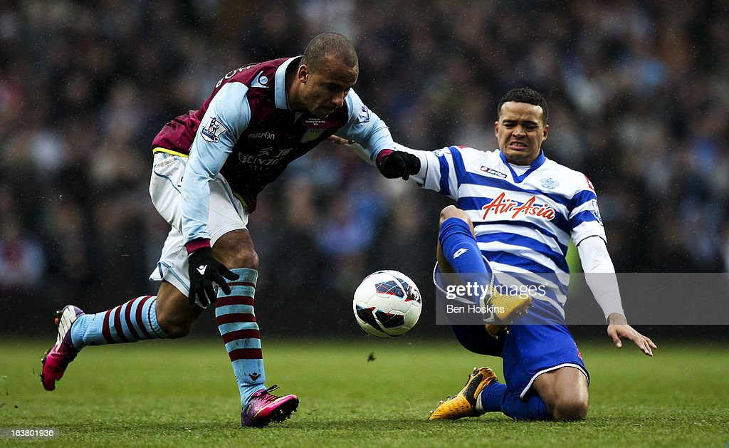 <a gi-track='captionPersonalityLinkClicked' href=/galleries/search?phrase=Gabriel+Agbonlahor&family=editorial&specificpeople=662025 ng-click='$event.stopPropagation()'>Gabriel Agbonlahor</a> of Aston Villa is tackled by <a gi-track='captionPersonalityLinkClicked' href=/galleries/search?phrase=Jermaine+Jenas&family=editorial&specificpeople=212775 ng-click='$event.stopPropagation()'>Jermaine Jenas</a> of QPR during the Barclays Premier League match between Aston Villa and Queens Park Rangers at Villa Park on March 16, 2013 in Birmingham, England.