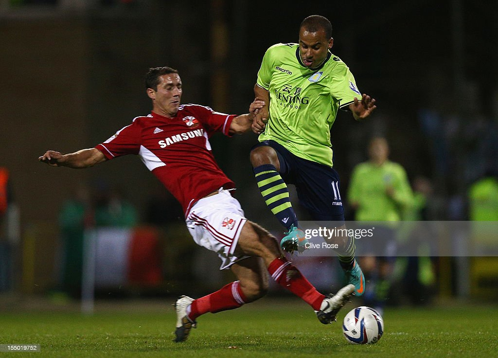 <a gi-track='captionPersonalityLinkClicked' href=/galleries/search?phrase=Gabriel+Agbonlahor&family=editorial&specificpeople=662025 ng-click='$event.stopPropagation()'>Gabriel Agbonlahor</a> of Aston Villa is tackled by Joe Devera of Swindon Town during the Capital One Cup Fourth Round match between Swindon Town and Aston Villa at the County Ground on October 30, 2012 in Swindon, England.