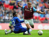 Gabriel Agbonlahor of Aston Villa is tackled by Jon Obi Mikel of Chelsea during the FA Cup sponsored by EON Semi Final match between Aston Villa and...