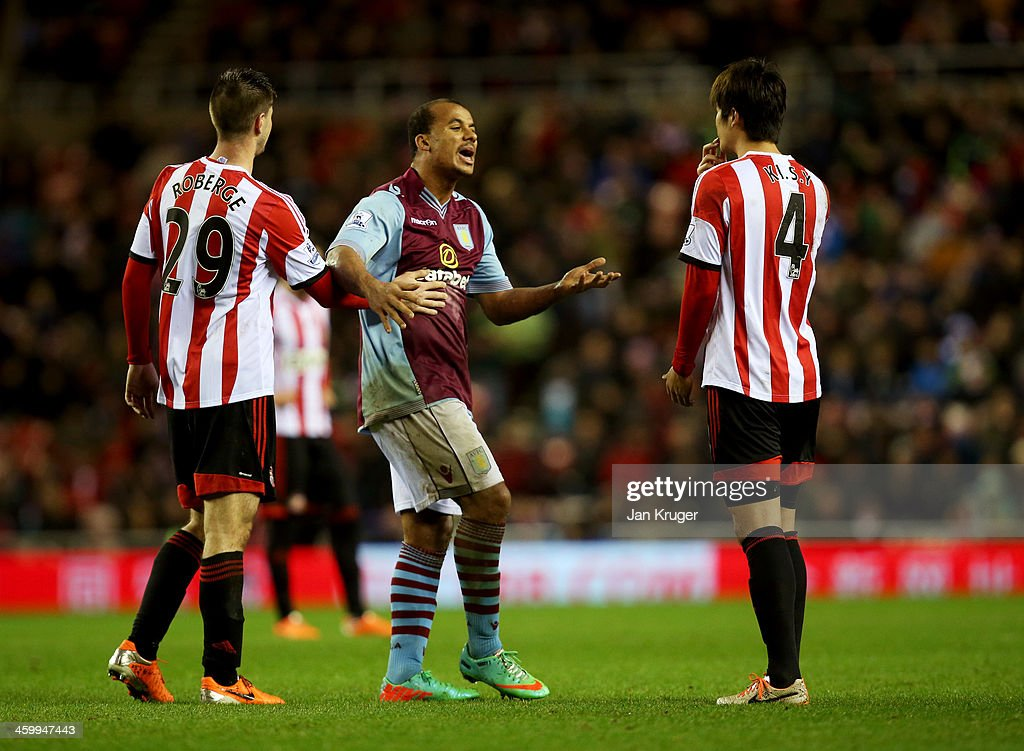 <a gi-track='captionPersonalityLinkClicked' href=/galleries/search?phrase=Gabriel+Agbonlahor&family=editorial&specificpeople=662025 ng-click='$event.stopPropagation()'>Gabriel Agbonlahor</a> of Aston Villa (C) reacts towards <a gi-track='captionPersonalityLinkClicked' href=/galleries/search?phrase=Ki+Sung-Yong&family=editorial&specificpeople=4252298 ng-click='$event.stopPropagation()'>Ki Sung-Yong</a> of Sunderland (R) as Valentin Roberge of Sunderland (L) intervenes during the Barclays Premier League match between Sunderland and Aston Villa at Stadium of Light on January 1, 2014 in Sunderland, England.