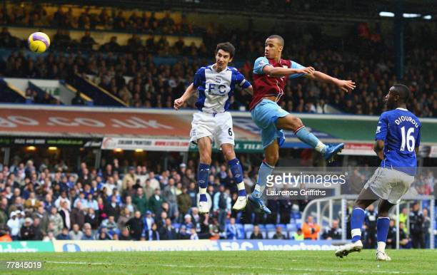 Gabriel Agbonlahor of Aston Villa scores the second goal under pressure from Liam Ridgewell of Birmingham during the Barclays Premier League match...