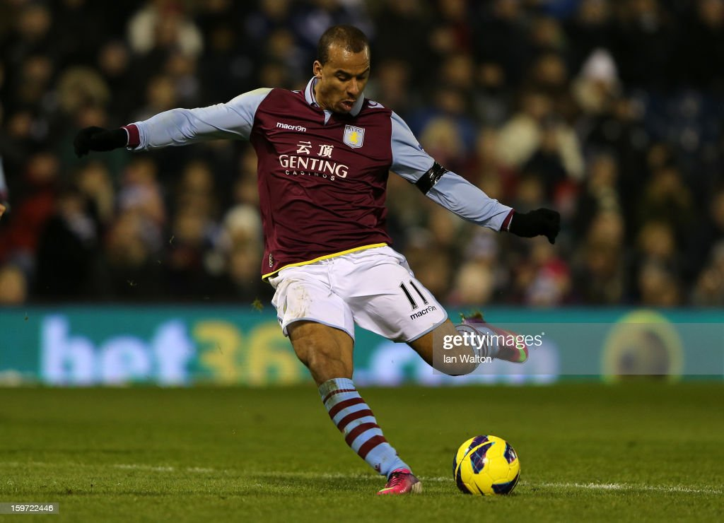 <a gi-track='captionPersonalityLinkClicked' href=/galleries/search?phrase=Gabriel+Agbonlahor&family=editorial&specificpeople=662025 ng-click='$event.stopPropagation()'>Gabriel Agbonlahor</a> of Aston Villa scores their second goal during the Barclays Premier League match between West Bromwich Albion and Aston Villa at The Hawthorns on January 19, 2013 in West Bromwich, England.