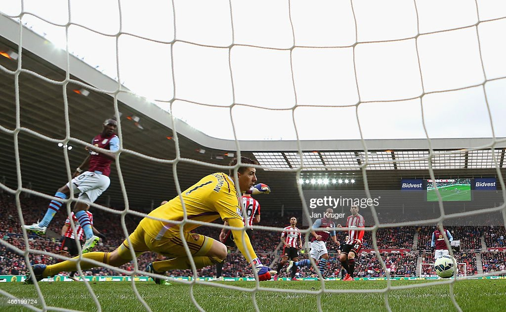 Gabriel Agbonlahor of Aston Villa scores their second goal past Costel Pantilimon of Sunderland during the Barclays Premier League match between Sunderland and Aston Villa at Stadium of Light on March 14, 2015 in Sunderland, England.