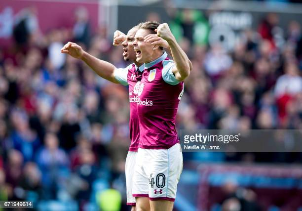 Gabriel Agbonlahor of Aston Villa with team mate Jack Grealish of Birmingham City after the Sky Bet Championship match between Aston Villa and...