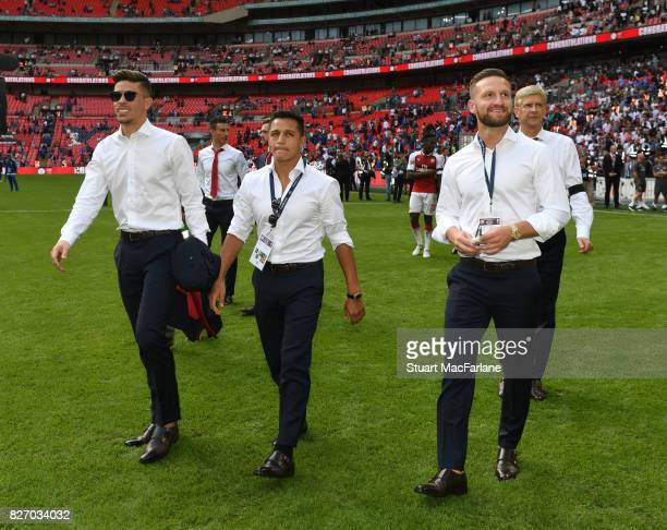 Gabriel Alexis Sanchez and Shkodran Mustafi of Arsenal during the FA Community Shield match between Chelsea and Arsenal at Wembley Stadium on August...
