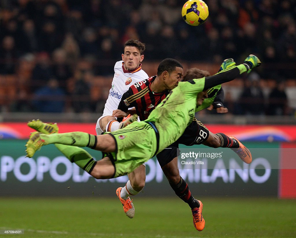 Gabriel and Urby Emanuelson #28 of AC Milan in action during the Serie A match between AC Milan and AS Roma at San Siro Stadium on December 16, 2013 in Milan, Italy.