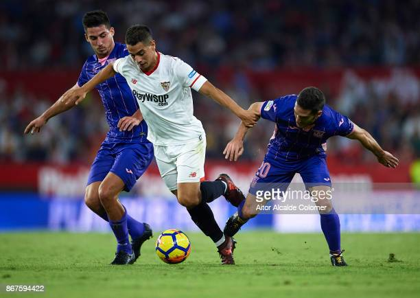 Gabriel Appelt of CD Leganes and Joseba Zaldua of CD Leganes compete for the ball with Wissam Ben Yedder of Sevilla FC during the La Liga match...