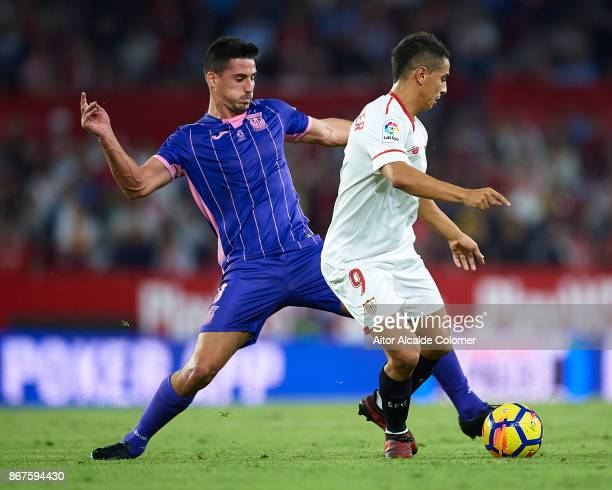 Gabriel Appelt of CD Leganes competes for the ball with Wissam Ben Yedder of Sevilla FC during the La Liga match between Sevilla and Leganes at...