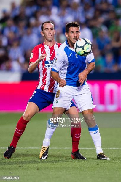 Gabriel Appelt Pires of CD Leganes fights for the ball with Diego Roberto Godin Leal of Atletico de Madrid during the La Liga 201718 match between CD...