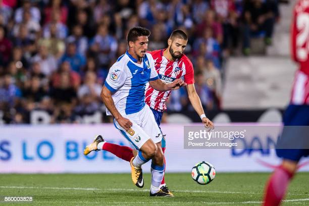 Gabriel Appelt Pires of CD Leganes fights for the ball with Yannick Ferreira Carrasco of Atletico de Madrid during the La Liga 201718 match between...