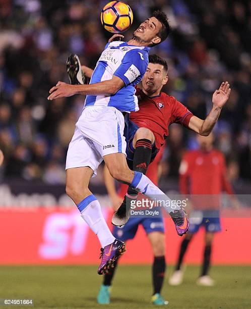 Gabriel Appelt Pires of CD Leganes is tackled by David Garcia of CA Osasuna during the La Liga match between CD Leganes and CA Osasuna at Estadio...
