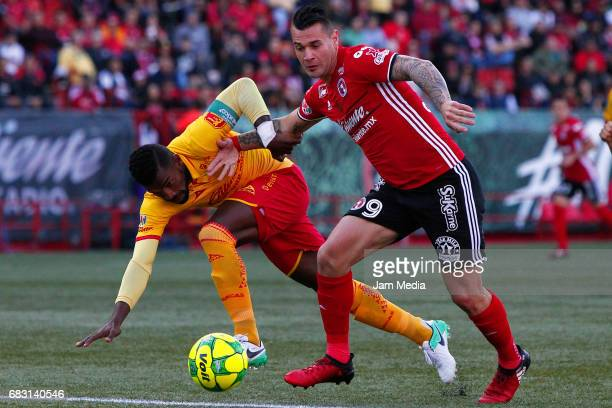 Gabriel Archilier of Morelia and Milton Caraglio of Tijuana fight for the ball during the quarter finals second leg match between Tijuana and Morelia...