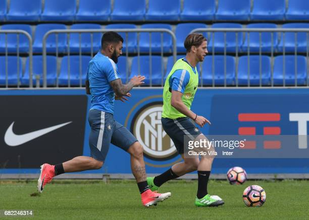 Gabriel Barbosa Almeida and Cristian Ansaldi of FC Internazionale compete for the ball during FC Internazionale training session at Suning Training...